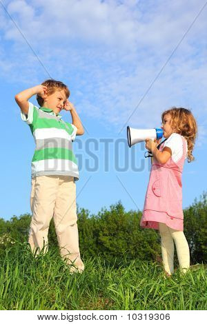 Children Have Fun On Nature, And Play With Loudspeaker.