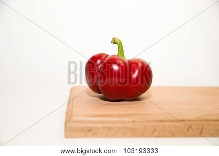 One Ripe Red Peppers On Over White