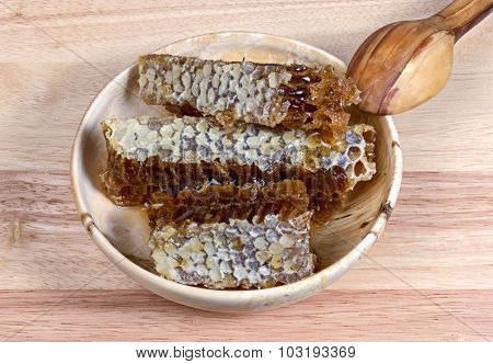 honey in a wooden bowl, cell