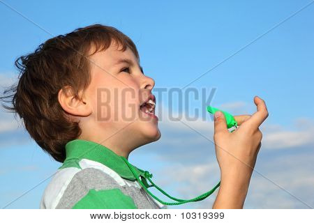 Small Boy, Against Blue Sky, Plays With green whistle