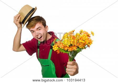 Young gardener with flower isolated on white