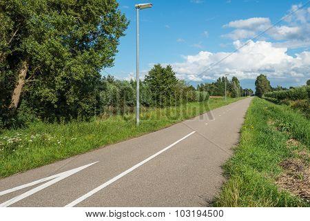 Straight Asphalt Road Through A Rural Area