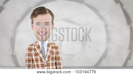 Geeky businessman against sheet spiral on grey wall