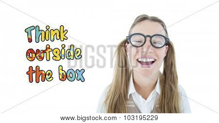 Female geeky hipster smiling at camera against think outside the box