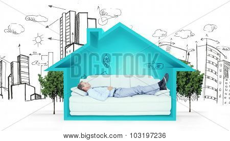 Businessman lying on sofa against house shape with living room sketch