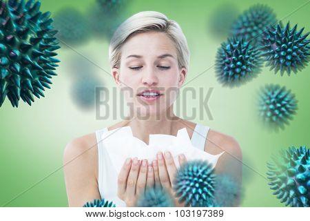 Sick woman holding tissues against green vignette