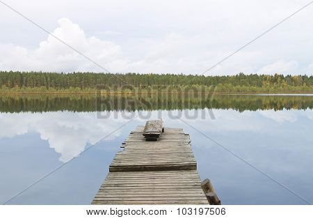 Water landscape: old wooden pier on the lake