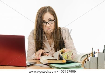 Frustrated Teacher Is Looking For Something In A Book