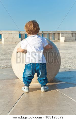 Young Baby Touch A Big Sphere, Concept Of Growth