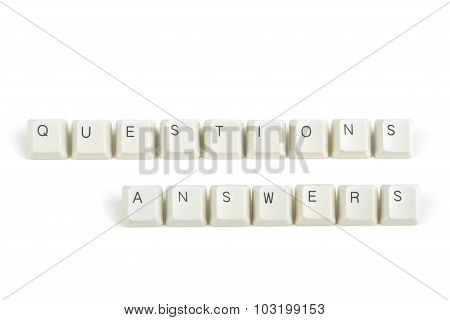 Questions Answers From Scattered Keyboard Keys On White
