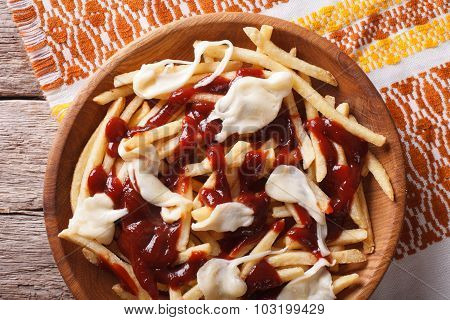 Poutine - French Fries With Gravy And Cheese. Horizontal Top View