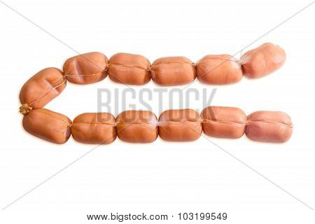 Uncooked Bangers In Natural Casing On A Light Background