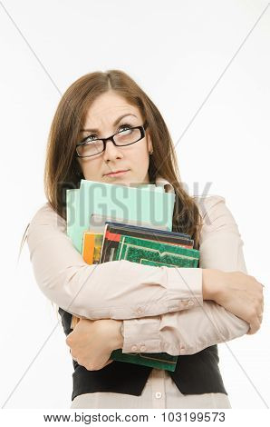 Thoughtful Teacher With Textbooks And Notebooks