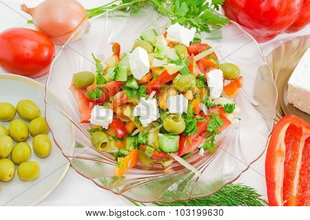 Greek Salad Closeup Among Ingredients For Its Preparation