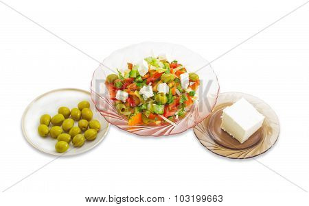 Greek Salad, Olives And Feta Cheese On A White Background