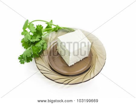 Feta Cheese On A Saucer And A Branch Cilantro