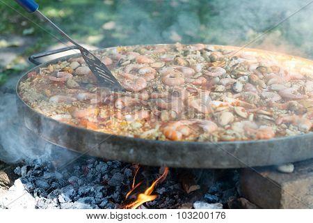 Preparing Paella In Large Pan