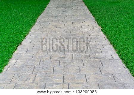 Ornament Stone Footpath With Pebble And Grass In The Garden