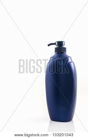 Dark Blue Bottle On A White Background.