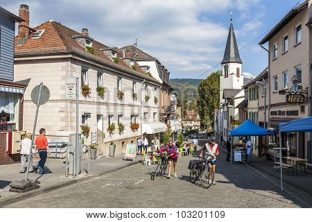 People Enjoy A Bicycle Tour In The Beautiful Historic Town Of Koenigstein