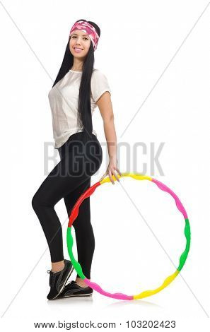 A girl in sport suit with hula hoop isolated on white