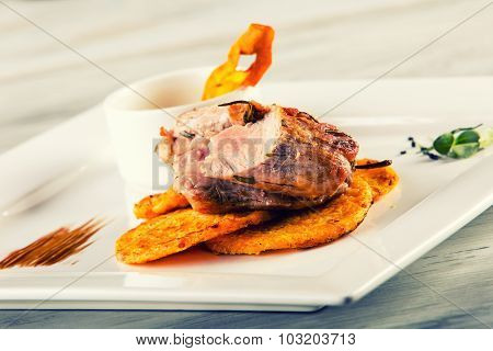 Culinary kitchen. French cuisine. Pork fillet. Recipe: Lightly smoked pork fillet pumpkin pancakes a