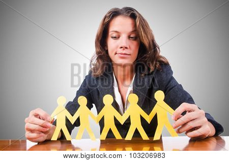 Woman with paper cut people