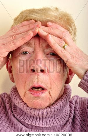 One Old Woman Has A Painfull Headache