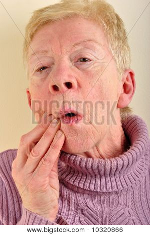 One Old Woman Holding Her Painful Jawbone