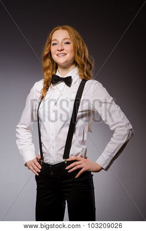 Red hair girl in classic style against gray