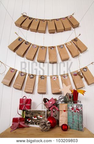 Handmade christmas presents. Hanging advent calendar, greeting cards and craft supplies for xmas in red, white, brown and green colors.