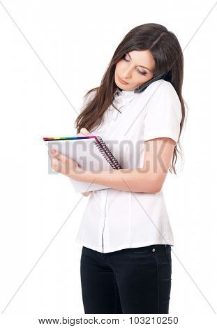 Young happy woman with notepad and phone, isolated on white background