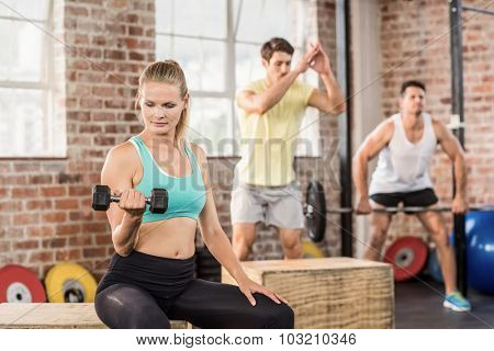 Fit people working out in crossfit gym