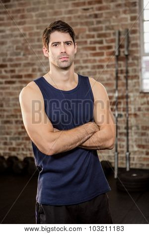Portrait of serious man with arms crossed at gym