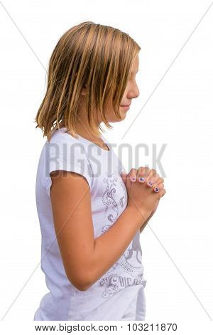 Girl Child Praying Isolated On White Background With Folded Hands, Side View Shot