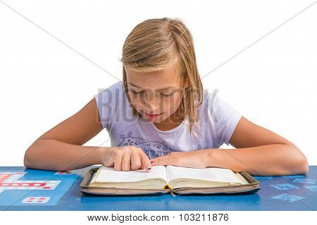 Young Child Girl Reading And Study Holy Bible At Blue Desk In Church Sunday School