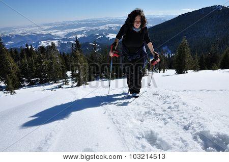 Girl Winter Trekking In The Snow