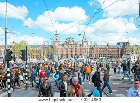 AMSTERDAM APR 27: People at the Central Station on Kings Day in Amsterdam on April 27. 2015 in the Netherlands