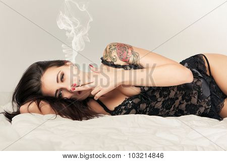 Brunette Girl In Bed With Cigarette