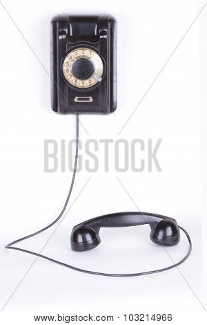 Old phone closeup isolated on white background