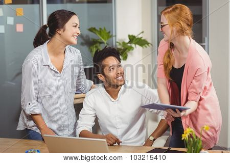 Happy business people at desk in office during meeting
