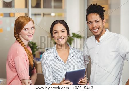 Portrait of confident business people smiling at office