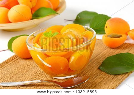 apricot compote dessert served in the glass bowl with spoon