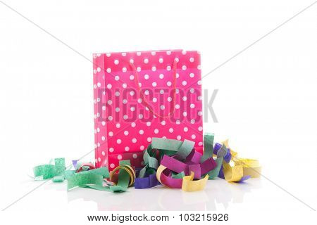 Birthday present with confetti isolated over white background