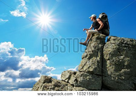 Man tourist on peak of mountain. Conceptual and travel scene.