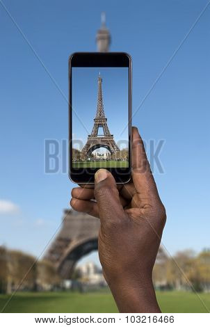 Man taking picture with mobile phone