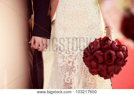 Joyful Bride And Groom On Wedding Day With Beautiful Tulip Bouquet