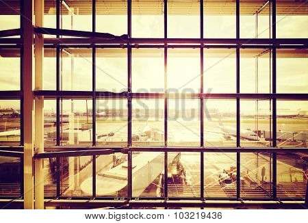 Vintage Filtered Picture Of An Airport, Transportation And Business Travel Concept.
