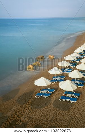 Beach with chairs and umbrellas in a resort
