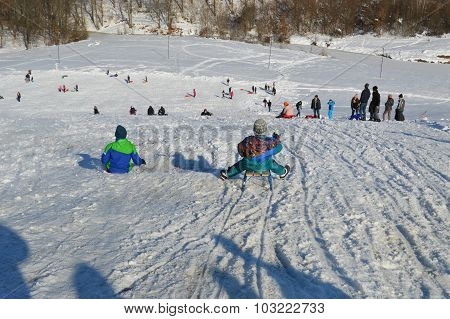 People on the snow covered mountain slopes